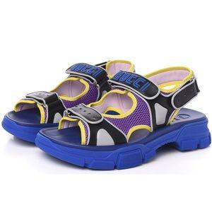 GUCCI Black and Blue Aguru Sega Logo Sandals NWT